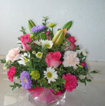 Pink roses with lilies and mixed assortment of flowers w/square vase