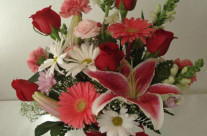 Red roses with pink lilies and assortment of pink and white flowers w/vase