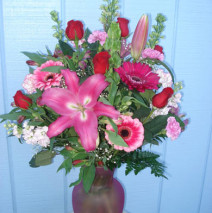 Red Roses and Various Pink Flowers in a Vase