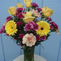 Yellow roses with purple many carnations and yellow gerbaras in a vase