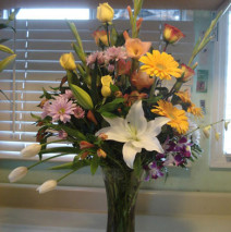 White, Yellow and Purple Flowers in a Vase