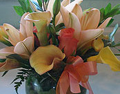 Asiatic Lilly's w/ Calla Lilly's in a Vase -