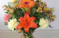 Assortment of yellow and orange flowers in a vase