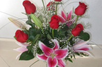 Red roses with pink lilies in a vase