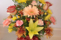 Mixed arrangement in a vase with Asiatic lilies