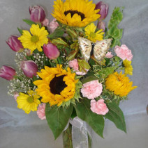 Sunflowers with a touch of pink tulips in a vase